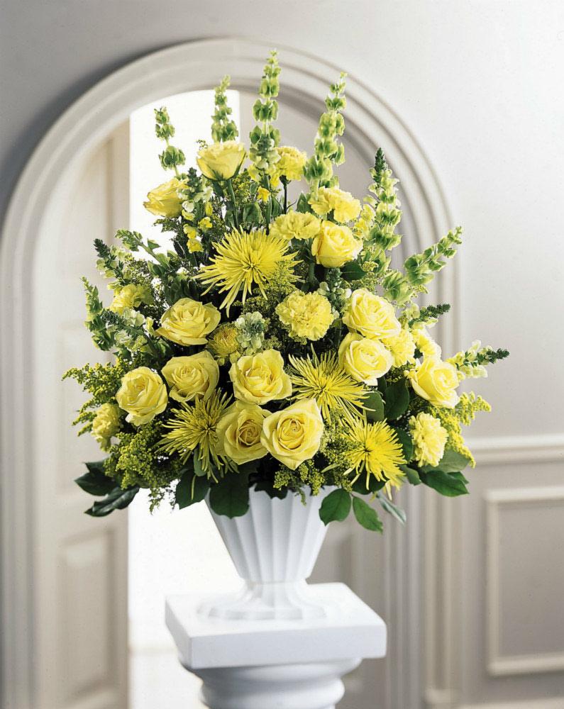 Yellow flowered funeral arrangement at ollies grower direct glowing blooms funeral arrangement izmirmasajfo
